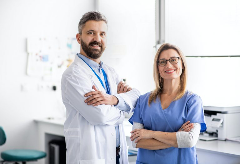 A dentist with dental assistant in modern dental surgery